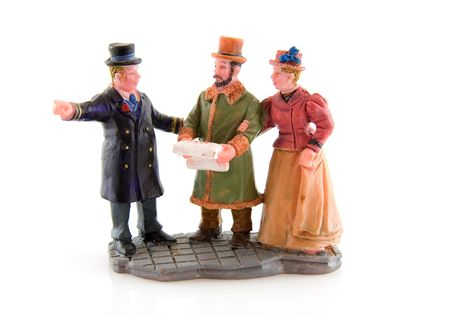 dickens: Miniature statue christmas people over white background