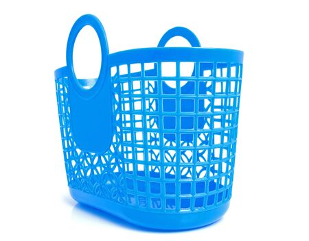 Blue plastic shopping bag with holes in closeup over white background photo