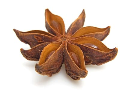 badian: whole star anise in closeup over white background Stock Photo
