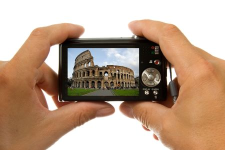 old ruin: Photo camera in hands taking picture of colosseum in Rome isolated on white background