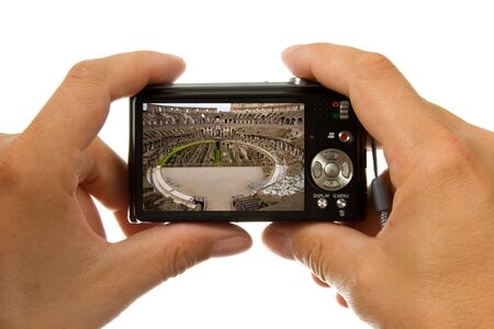 Photo camera in hands taking picture of the inside of colosseum in Rome isolated on white background photo