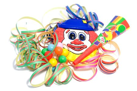 party decoration with horn, clown and streamers over white background Stock Photo - 6354199