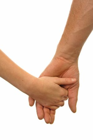 Adult man and child holding hands over white background photo