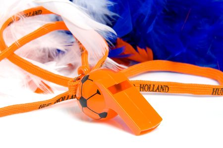Orange flute in shape of soccer ball with accessories for Dutch game Stock Photo