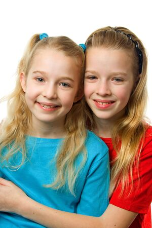 portrait of two young blonde girls looking in camera over white background Stock Photo - 6450779