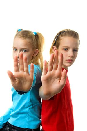 rejections: two caucasian girls making stop sign with hands over white background