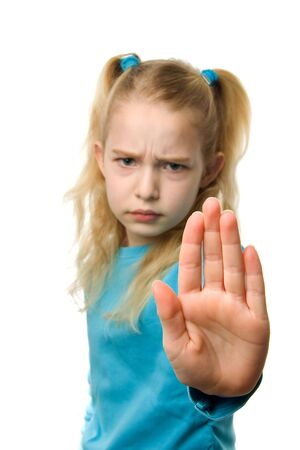 one caucasian girl is making stop sign with hand, sharp on hand and blur on girl, over white background Stock Photo - 6450762