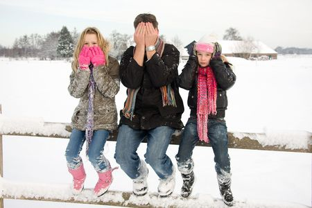 three people in snow showing speak, see and hear no evil Stock Photo - 6450771