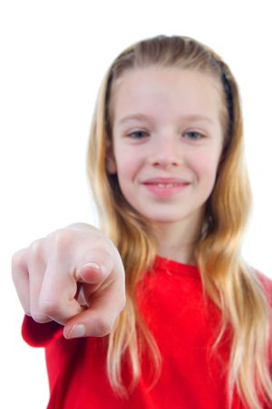designate: Girl is pointing at you over white background, girl is blur and hand is sharp