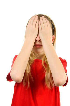 Young blonde girl covers her eyes: see no evil, isolated on white background Stock Photo - 6450768