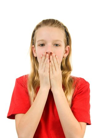 Young blonde girl covers her mouth: speak no evil, isolated on white background photo