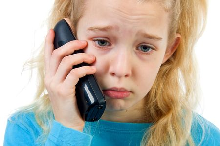 sad girl on the phone, bad news, isolated on white background Stock Photo