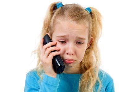 bawl: sad girl on the phone, bad news, isolated on white background Stock Photo