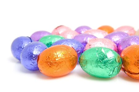 colorful chocolate easter eggs over white background photo