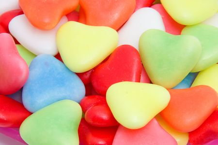 Background of colorful hearts candy in closeup Stock Photo