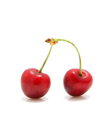 Two fresh red cherries over white background Stock Photo - 6481962