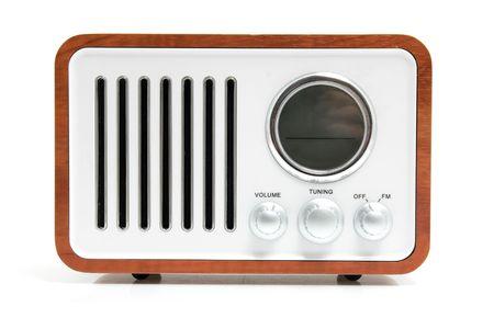 Old fashioned radio isolated on white background photo