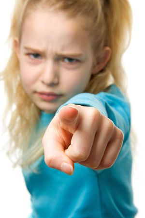 Angry girl is pointing at you, finger closeup, girl in blur Stock Photo - 6550434