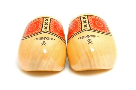 pair of traditional Dutch yellow wooden shoes over white background Stock Photo - 6550999