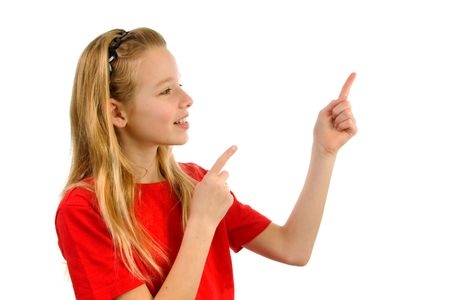 denote: Young blonde girl points to something. Isolated on white background