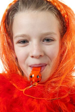 Girl is posing in orange outfit for soccer game or queensday over white background photo