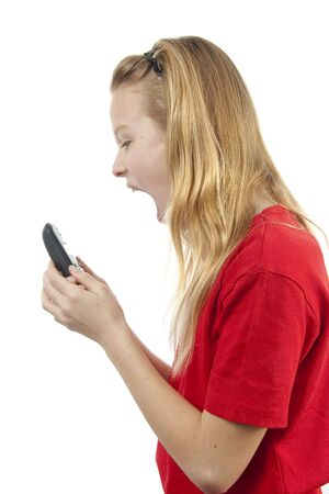 Girl is angry on the phone over white background Stock Photo - 6676887