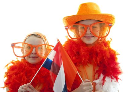 Two girls posing in orange outfit for soccer game or Dutch Queensday over white background Stock Photo