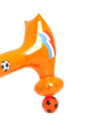 blow up: Blow up hammer over orange soccer ball isolated on white background