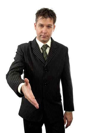 Businessman is shaking your hand over white background photo
