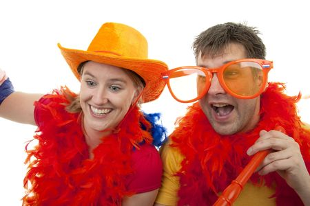 Two Dutch soccer fans in orange outfit cheering for the WK games, over white background Stock Photo - 6839601