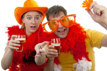 Two Dutch soccer fans in orange outfit cheering for the WK games, over white background Stock Photo - 6839620