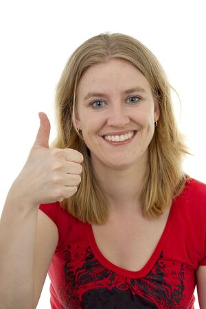 gratified: Young woman with thumbs up over white background Stock Photo