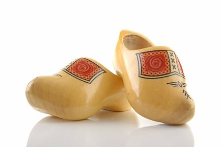 klompen: Pair of traditional yellow wooden shoes isolated on white background