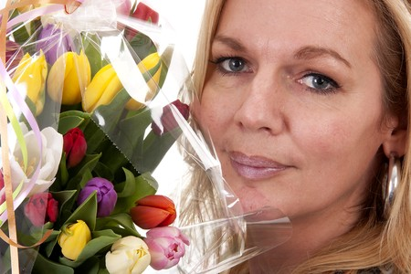 Woman with Dutch tulip flowers in closeup over white background Stock Photo - 6914270