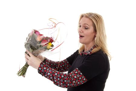 Woman gets flowers for mothers day or birthday over white background Stock Photo - 6915265