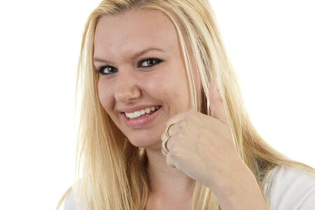 gratified: Young blonde woman with thumbs up over white background