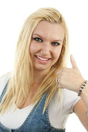 Young blonde woman with thumbs up over white background Stock Photo - 6914362