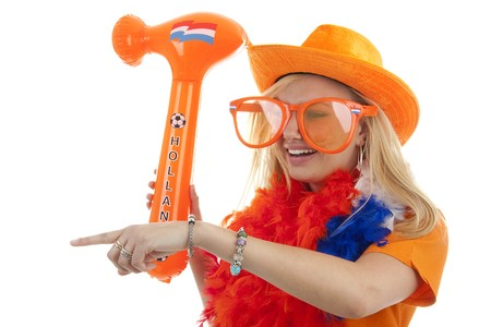 soccer supporter in orange outfit with blown up hammer over white background Stock Photo - 6914369