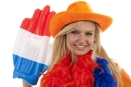portrait of Dutch soccer fan in orange outfit with big glasses, hat and big hand over white background Stock Photo - 6914361