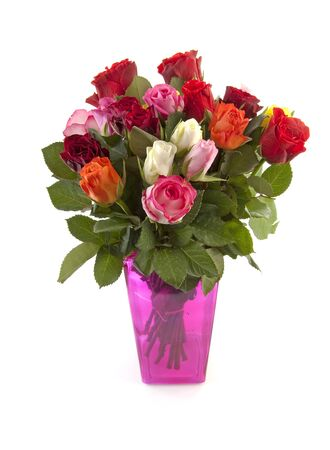 Bouquet of colorful roses in pink vase over white background