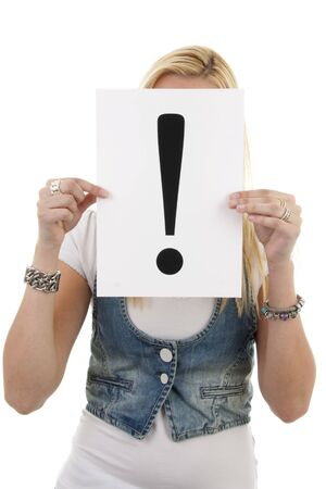 Woman is holding a exclamation mark over white background photo