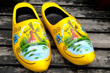 klompen: Painted typical Dutch yellow wooden shoes in closeup