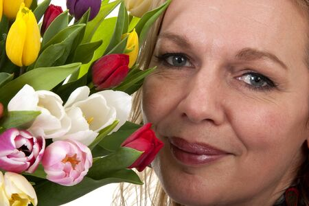 Woman with Dutch tulip flowers in closeup over white background Stock Photo - 6996419
