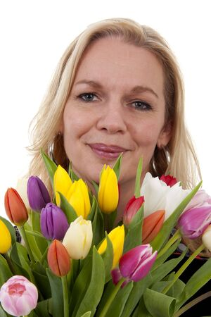 Woman with Dutch tulip flowers in closeup over white background Stock Photo - 6996387