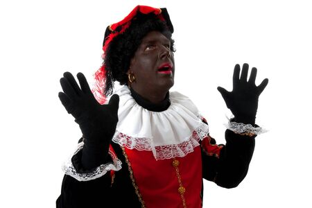 surprised Zwarte piet ( black pete) typical Dutch character part of a traditional event celebrating the birthday of  Sinterklaas in december over white background Stock Photo - 6996347