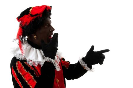 surprised Zwarte piet ( black pete) typical Dutch character part of a traditional event celebrating the birthday of  Sinterklaas in december over white background pointing Stock Photo - 6996346
