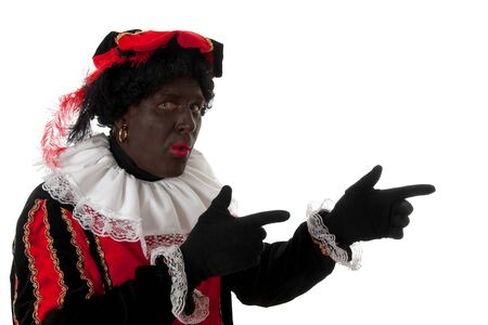 surprised Zwarte piet ( black pete) typical Dutch character part of a traditional event celebrating the birthday of  Sinterklaas in december over white background is pointing Stock Photo - 6996376