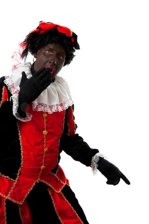 surprised Zwarte piet ( black pete) typical Dutch character part of a traditional event celebrating the birthday of  Sinterklaas in december over white background is pointing Stock Photo - 6996348