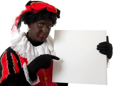 Zwarte piet ( black pete) typical Dutch character part of a traditional event celebrating the birthday of  Sinterklaas in december over white background is holding empty text board photo