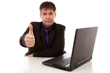 Businessman is pleased, holding thumbs up, over white background Stock Photo - 6996385